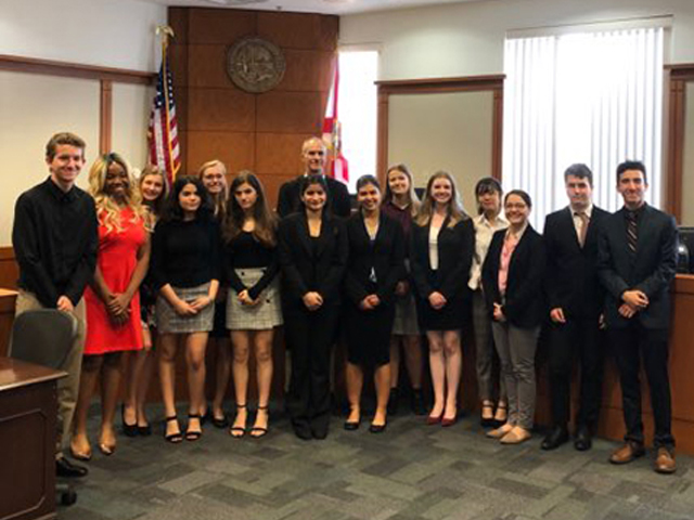 Judge Walker and Students at Mock Trial