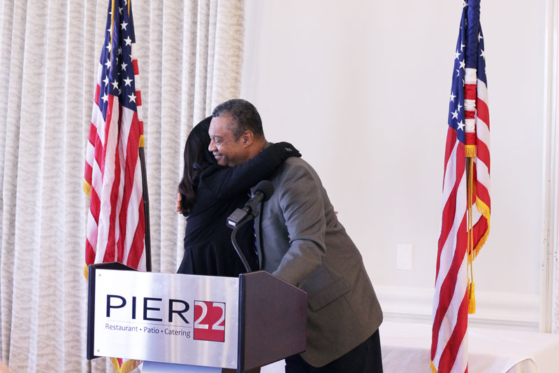 Chief Judge Charles E. Williams and Heather Doyle Hugging at podium